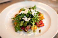 Close-up of Arugula Salad on Plate Stock Photo - Premium Royalty-Freenull, Code: 600-05803396