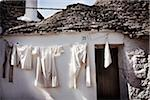 Laundry Drying on Clothesline, Salento, Puglia, Italy Stock Photo - Premium Rights-Managed, Artist: Siephoto, Code: 700-05803437
