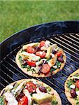 Homemade, Gourmet Pizzas on Barbecue Grill Stock Photo - Premium Royalty-Free, Artist: Edward Pond, Code: 600-05803547