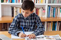 Boy Doing Homework Stock Photo - Premium Rights-Managednull, Code: 700-05803524