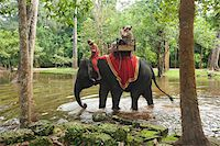 People Riding Elephant, Bayon Temple, Angkor Thom, Siem Reap, Cambodia Stock Photo - Premium Rights-Managednull, Code: 700-05803542