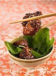 Sweet and sour pork with sesame seeds and spinach shoots Stock Photo - Premium Royalty-Freenull, Code: 652-05806907