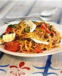 Linguini with mozzarella, tomatoes and herbs Stock Photo - Premium Royalty-Freenull, Code: 652-05806925