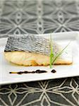 Oven-baked bass steak with black olive puree Stock Photo - Premium Royalty-Freenull, Code: 652-05808089