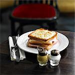 Ham and cheese  toasted sandwich topped with grilled cheese Stock Photo - Premium Royalty-Free, Artist: Photocuisine, Code: 652-05809307