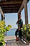 Beautiful girl on a beachhouse balcony Stock Photo - Premium Rights-Managed, Artist: urbanlip.com, Code: 847-05809849