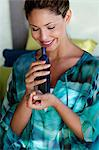 Beautiful girl smelling oil bottle Stock Photo - Premium Rights-Managed, Artist: urbanlip.com, Code: 847-05809865