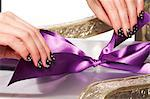 Beautiful manicured hands wrapping a present Stock Photo - Premium Rights-Managed, Artist: urbanlip.com, Code: 847-05809963