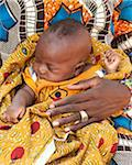 Baby in Mother's Arms, Mali, West Africa Stock Photo - Premium Rights-Managed, Artist: Peter Christopher, Code: 700-05810135