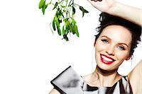 Glamorous brunette girl holding mistletoe Stock Photo - Premium Rights-Managednull, Code: 847-05810107