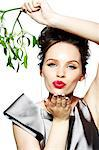 Glamorous brunette girl holding mistletoe and blowing a kiss Stock Photo - Premium Rights-Managed, Artist: urbanlip.com, Code: 847-05810111