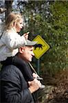 Toddler on shoulders of man at zoo with sign. Stock Photo - Premium Royalty-Free, Artist: Minden Pictures, Code: 6106-05810479