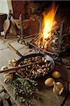 Cooking chestnuts in pan by fireplace Stock Photo - Premium Rights-Managed, Artist: Photocuisine, Code: 825-05811460