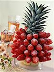 Pinapple decorated with strawberries Stock Photo - Premium Rights-Managed, Artist: Photocuisine, Code: 825-05812378