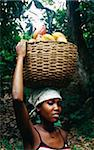 Women carrying cocoa beans in a basket on her head Stock Photo - Premium Rights-Managed, Artist: Photocuisine, Code: 825-05812593