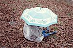Child sitting under umbrella Stock Photo - Premium Royalty-Free, Artist: Uwe Umsttter, Code: 632-05816103