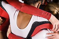 preteen girls gymnastics - Female gymnasts embracing, cropped Stock Photo - Premium Royalty-Freenull, Code: 632-05816336