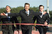 finish line - Businessman crossing finish line in race Stock Photo - Premium Royalty-Freenull, Code: 632-05816338