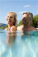Mature couple relaxing together in pool Stock Photo - Premium Royalty-Freenull, Code: 632-05816342