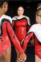 preteen girls gymnastics - Team of gymnasts holding hands Stock Photo - Premium Royalty-Freenull, Code: 632-05816459