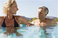 Retired couple soaking in pool Stock Photo - Premium Royalty-Freenull, Code: 632-05816481
