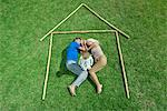 Little girl awake, parents sleeping, together within outline of house, high angle view Stock Photo - Premium Royalty-Free, Artist: Science Faction, Code: 632-05816655
