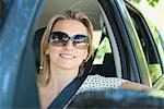 Woman in car, smiling out window, portrait Stock Photo - Premium Royalty-Free, Artist: Cultura RM, Code: 632-05816799