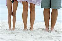 Family standing on beach, low section Stock Photo - Premium Royalty-Freenull, Code: 632-05816997