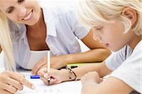Mother helping son with homework Stock Photo - Premium Royalty-Freenull, Code: 632-05817041