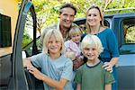 Family posing beside car, portrait Stock Photo - Premium Royalty-Free, Artist: ableimages, Code: 632-05817099