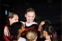 preteen girls gymnastics - Team of female gymnasts embracing Stock Photo - Premium Royalty-Freenull, Code: 632-05817119