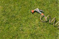 Garden hose with shower attachment, Hamburg, Germany Stock Photo - Premium Royalty-Freenull, Code: 628-05817348
