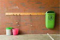 Green trash can and buckets at brick wall, Hamburg, Germany Stock Photo - Premium Royalty-Freenull, Code: 62