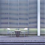 Table and chairs in front of a facade Stock Photo - Premium Royalty-Free, Artist: R. Ian Lloyd, Code: 628-05817393