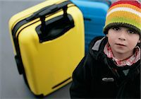 Boy looking at camera, Munich airport, Bavaria, Germany Stock Photo - Premium Royalty-Freenull, Code: 628-05817423