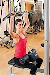 Woman exercising at a health club Stock Photo - Premium Royalty-Free, Artist: urbanlip.com, Code: 628-05817570