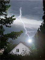 storm lightning - Lightning strikes into house Stock Photo - Premium Royalty-Freenull, Code: 628-05817574
