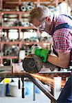 Metal worker using circular saw Stock Photo - Premium Royalty-Free, Artist: Blend Images, Code: 628-05817678