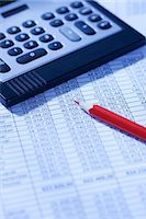 Pocket calculator and red pencil on spreadsheet Stock Photo - Premium Royalty-Freenull, Code: 628-05817690