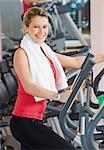 Woman exercising at a health club Stock Photo - Premium Royalty-Freenull, Code: 628-05817721