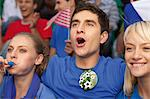 Fans in a soccer stadium Stock Photo - Premium Royalty-Free, Artist: Blend Images, Code: 628-05817771