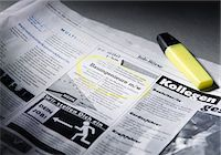Job advertisement in newspaper marked with highlighter Stock Photo - Premium Royalty-Freenull, Code: 628-05817981