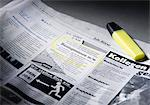 Job advertisement in newspaper marked with highlighter Stock Photo - Premium Royalty-Free, Artist: Blend Images, Code: 628-05817981