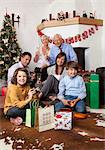 Grandparents, parents and children sitting at Christmas tree Stock Photo - Premium Royalty-Free, Artist: Siephoto, Code: 628-05817996