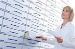Pharmacist in front of a cabinet Stock Photo - Premium Royalty-Free, Artist: AWL Images, Code: 628-05818017