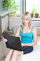 Woman using laptop at home, Munich, Bavaria, Germany Stock Photo - Premium Royalty-Freenull, Code: 628-05818073