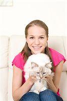 preteen girl pussy - Happy teenage girl with cat, Munich, Bavaria, Germany Stock Photo - Premium Royalty-Freenull, Code: 628-05818116