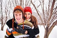 Young couple having fun outside in the snow. Stock Photo - Premium Royalty-Freenull, Code: 618-05818275