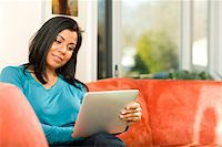 Mixed Race Women At Home Stock Photo - Premium Royalty-Freenull, Code: 618-05818318