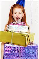 Screaming girl with stack of birthday gifts Stock Photo - Premium Royalty-Freenull, Code: 614-05819070